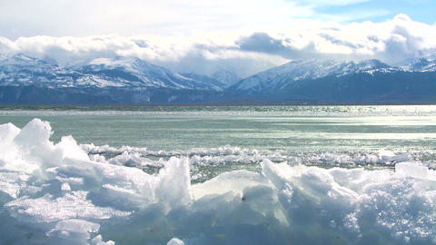 Ice forms in time lapse on the shore of a beautifu Footage