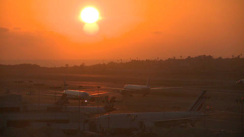 Planes taxi at sunset or sunrise at a major metrop Stock Video Footage