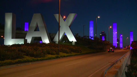 Cars pass by the LAX sign on their way into Los An Footage