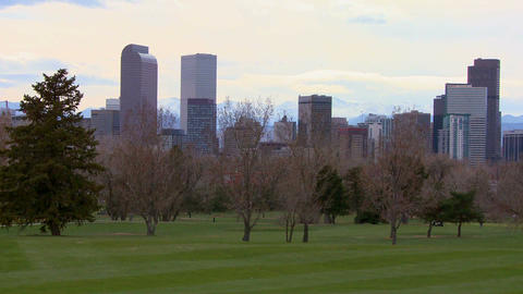 The Denver skyline against the Rocky mountains Stock Video Footage