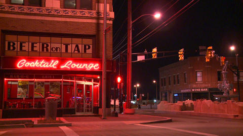 A neighborhood corner cocktail lounge at night Stock Video Footage