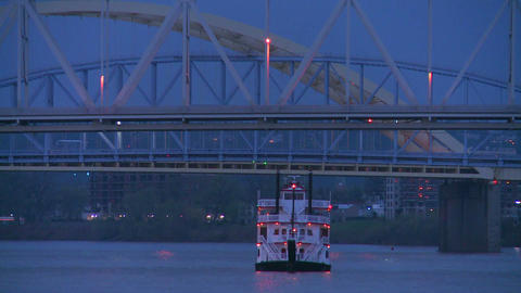 A riverboat passes under the bridges of Cincinnati Footage