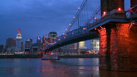 A riverboat travels at night with the Cincinnati O Stock Video Footage