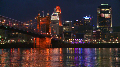 Light reflects off the Ohio River with the city of Footage
