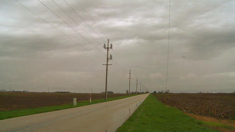 A lonely road across the flatlands in the midwest Stock Video Footage