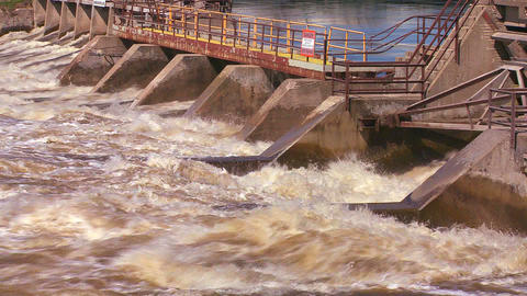 A dam handles fast flowing water in a river Footage