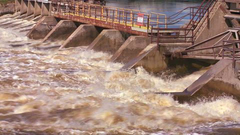 A dam handles fast flowing water in a river Stock Video Footage