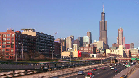Cars drive on a freeway heading into Chicago, Illi Footage