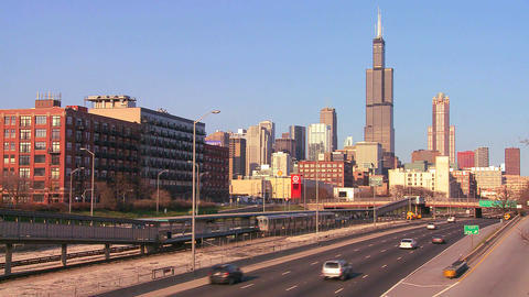 Cars drive on a freeway heading into Chicago, Illi Stock Video Footage