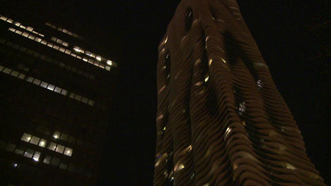 Nighttime shot look up at unusual apartment buildi Stock Video Footage