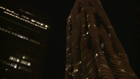 Nighttime shot look up at unusual apartment buildi Footage