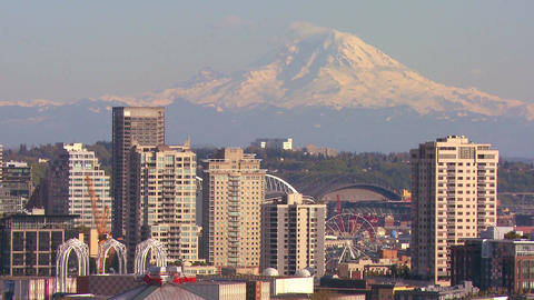 Telephoto shot of Mt. Rainier looming over the sky Stock Video Footage