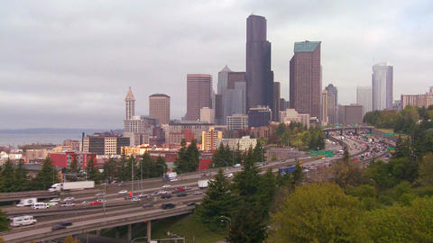 Traffic moves along a busy freeway into Seattle Wa Footage