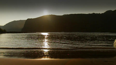 A gorgeous shot as a fisherman walks in front of t Stock Video Footage