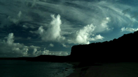 Beautiful clouds in time lapse flow over steep cli Stock Video Footage
