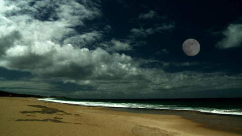 The full moon over a beautiful sandy beach Stock Video Footage