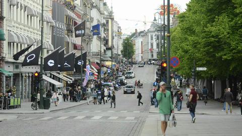Time lapse of people walking on a sidewalk in Oslo Footage