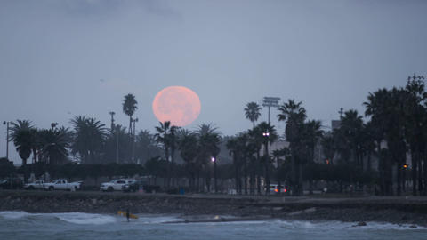 Time lapse of the full moon setting over Surfers P Footage