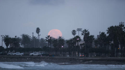 Time lapse of the full moon setting over Surfers P Stock Video Footage
