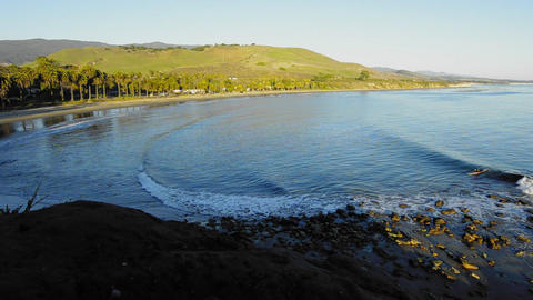 A solo surfer catching a wave at Refugio State Bea Stock Video Footage