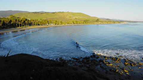 A solo surfer catching a wave at Refugio State Bea Footage