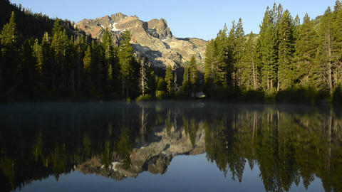 A morning reflection of the Sierra Buttes on Sand  Footage