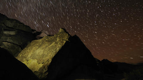 Time lapse star trail streaks over a sacred Owens Stock Video Footage