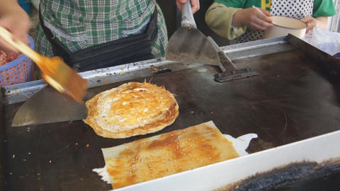 Cooking of fried pancakes. Сhinese fast-food 02 Stock Video Footage
