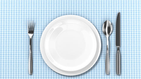 Plates, fork, spoon and knife appear on table. HD Stock Video Footage
