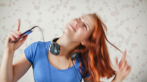 The girl listens to music Footage
