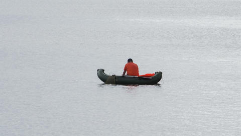 Fisherman and boat on lake waves. Shot in RAW, wid Stock Video Footage