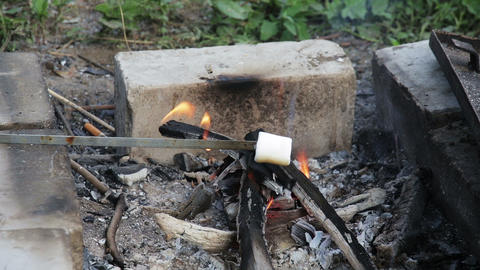 Marshmallow roasted in campfire and getting bronze Footage
