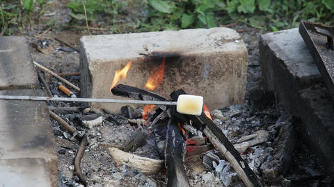 Marshmallow roasted in campfire and getting bronze Stock Video Footage