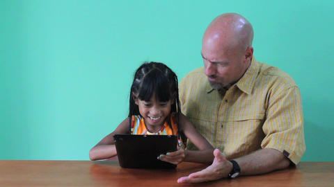 Asian Daughter Showing Dad Tricks On Digital Table Stock Video Footage