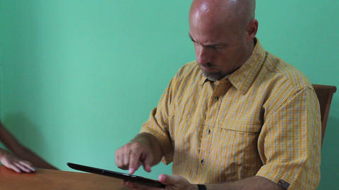 Daughter Hijacking Digital Tablet From Dad Stock Video Footage