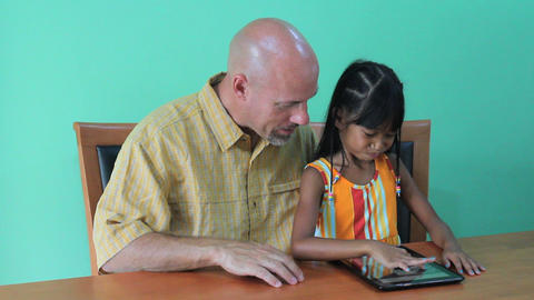 Father Helps Daughter Use Digital Tablet Stock Video Footage