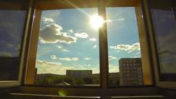 The sun shines through the open window Footage