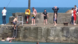 Boys Jumping into the Sea Footage