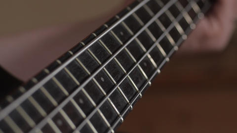 Musician playing bass guitar Stock Video Footage