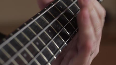 Musician playing bass guitar Stock Video Footage