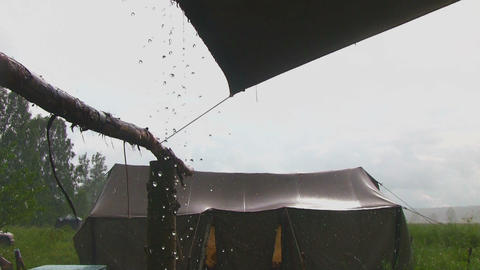 Heavy rain falling on a tent Footage