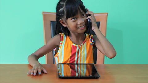 Asian Girl Talks On Smart Phone Stock Video Footage