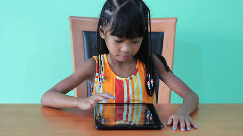 Cute Girl Playing Games On Digital Tablet Footage