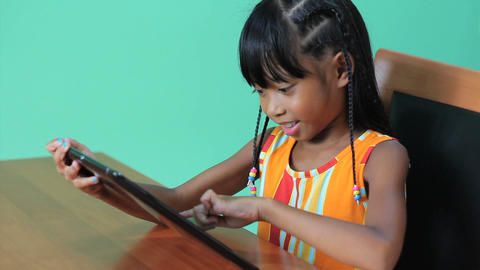 Little Asian Girl Uses Digital Tablet Stock Video Footage
