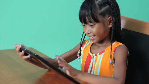 Little Asian Girl Uses Digital Tablet Footage