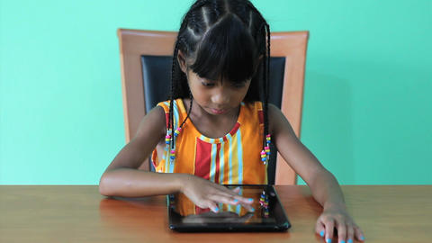 Seven Year Old Asian Girl Using Digital Tablet Footage