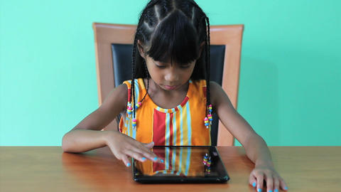 Seven Year Old Asian Girl Using Digital Tablet Stock Video Footage