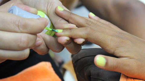 Yellow Paint On Finger Nails During Manicure Stock Video Footage
