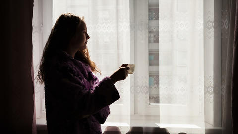 Woman drinking coffee in the morning Stock Video Footage