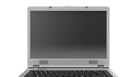 Laptop turning on white background with reflection Stock Video Footage